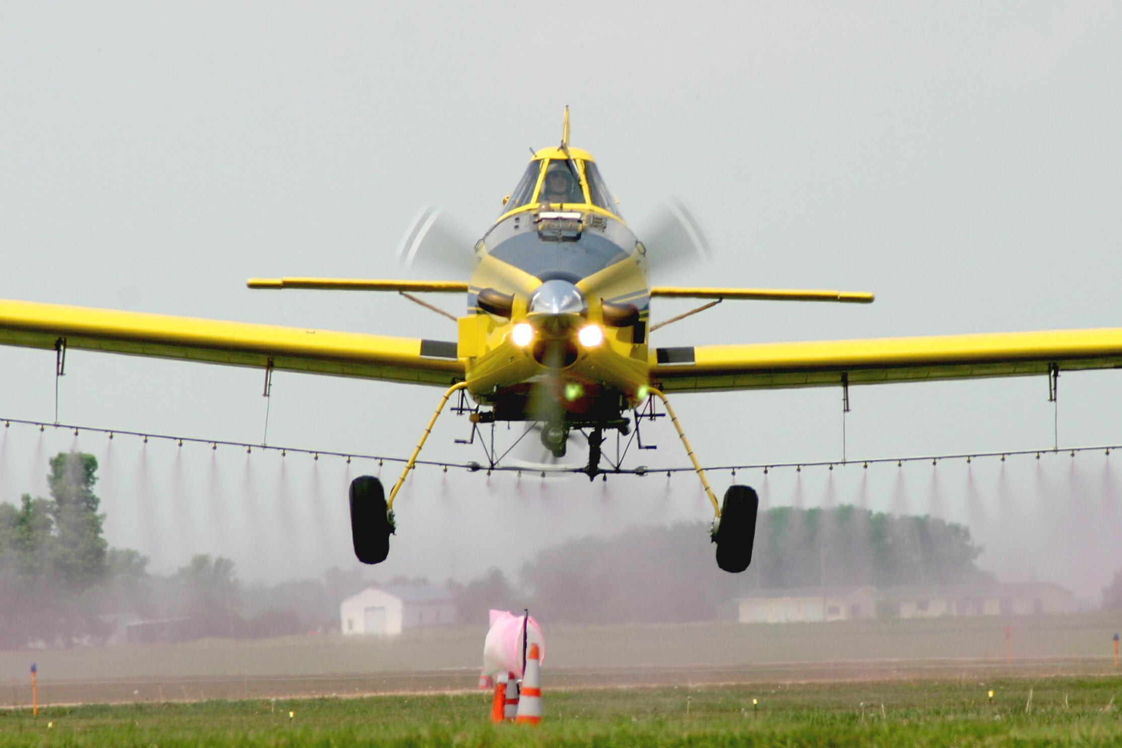 yellow spray plane