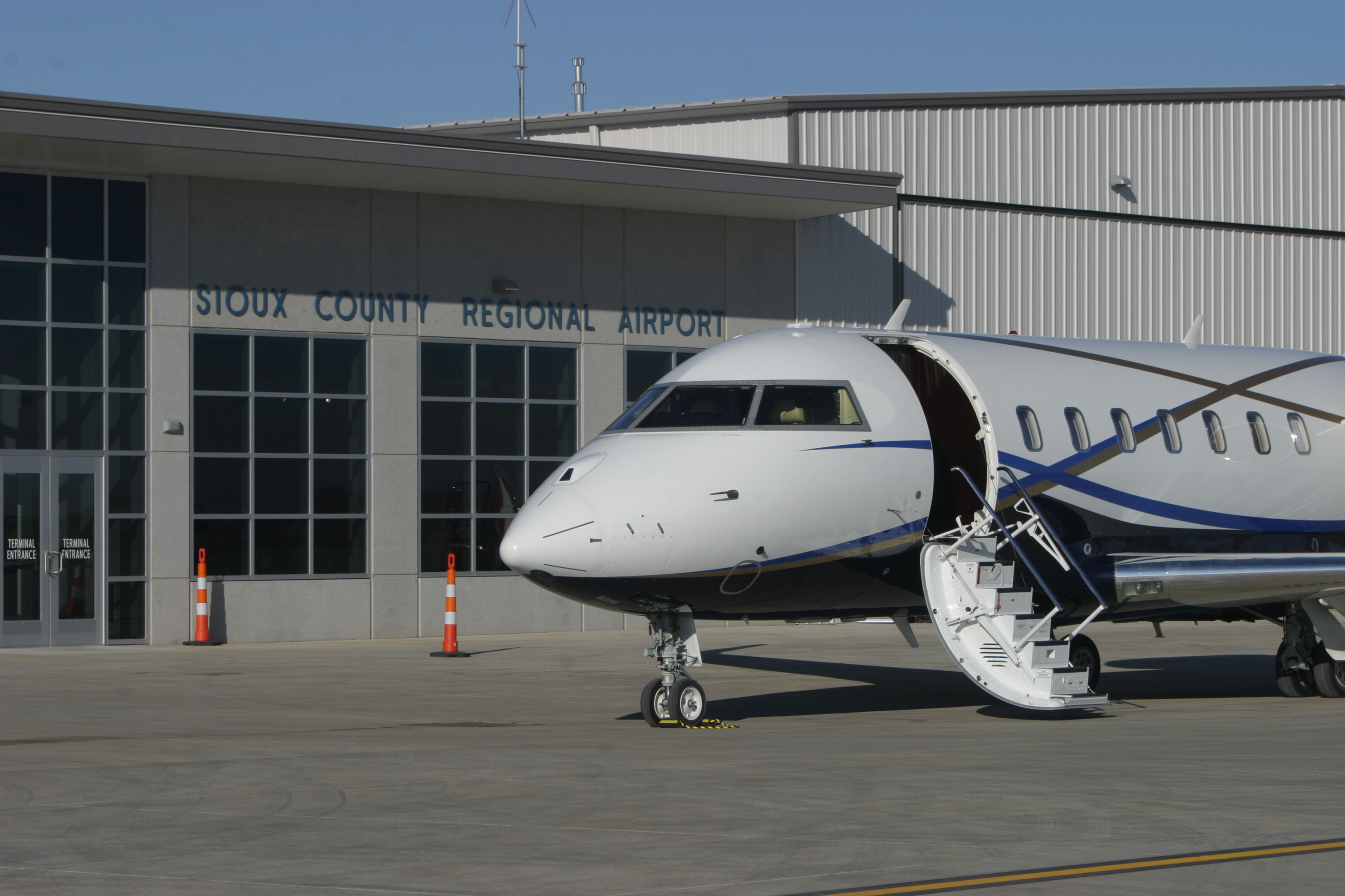 Air Flair exterior with commercial plane